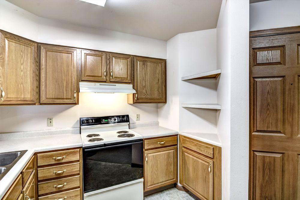 kitchen stove and brown cabinets