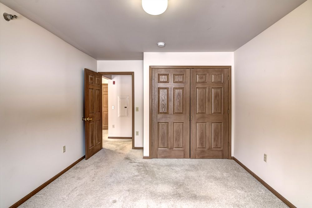 bedroom facing door and closet